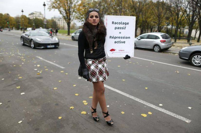 600850-a-sex-worker-activist-attends-a-demonstration-with-prostitutes-against-a-proposal-to-scrap-sanctions